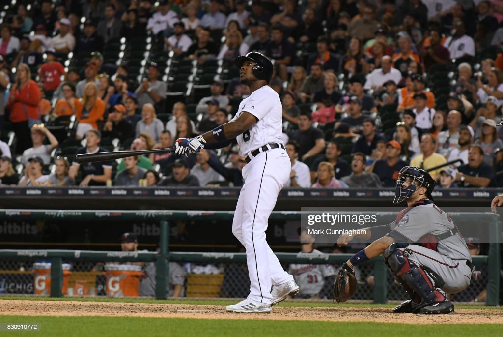 Justin Upton #8 of the Detroit Tigers hits a walk-off two-run home run in the bottom of the ninth inning of the game against the Minnesota Twins at Comerica Park on August 12, 2017 in Detroit, Michigan. The Tigers defeated the Twins 12-11.