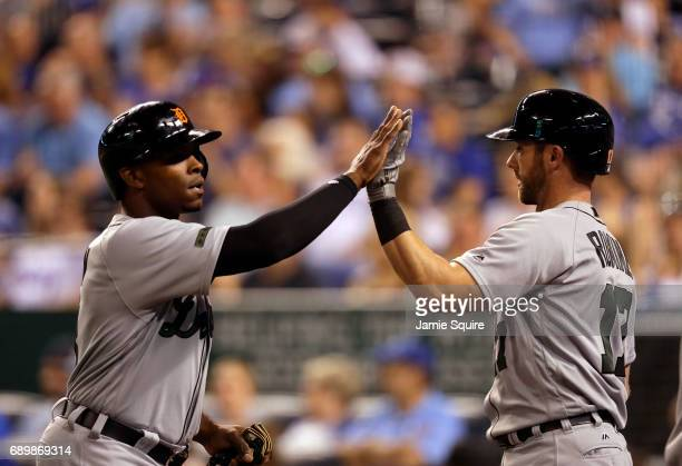 Justin Upton of the Detroit Tigers is congratulated by Andrew Romine after scoring during the 8th inning of the game against the Kansas City Royals...