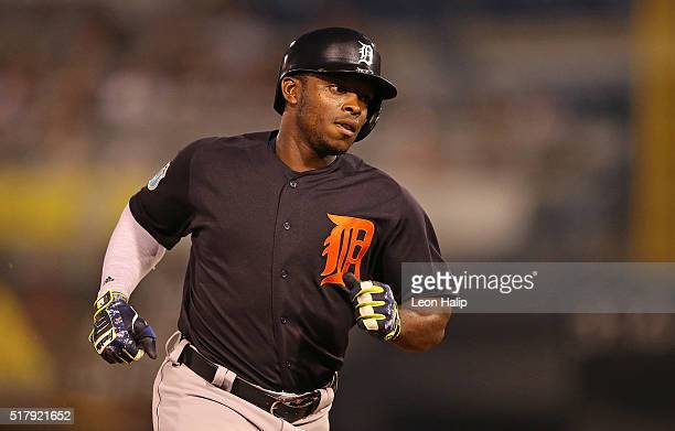 Justin Upton of the Detroit Tigers rounds second base after hitting a solo home run to right field during the sixth inning of the Spring Training...