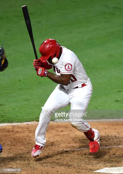 Justin Upton of the Los Angeles Angels is hit in the head by a 94 mph pitch throw by Demarcus Evans of the Texas Rangers, in his major league debut...
