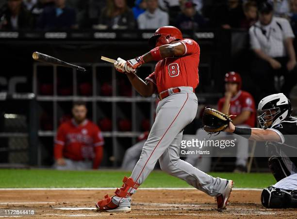 Justin Upton of the Los Angeles Angels of Anaheim breaks his bat in the second inning against the Chicago White Sox at Guaranteed Rate Field on...