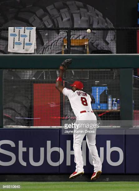 Justin Upton of the Los Angeles Angels of Anaheim can't reach the three run home run ball hit by Andrew McCutchen of the San Francisco Giants in the...