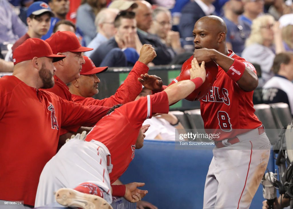 Justin Upton #8 of the Los Angeles Angels of Anaheim is congratulated by teammates after scoring a run in the ninth inning against the Toronto Blue Jays at Rogers Centre on May 23, 2018 in Toronto, Canada.
