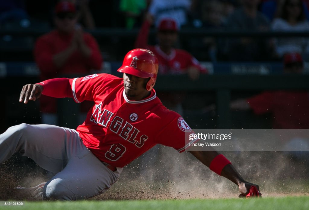 Justin Upton #9 of the Los Angeles Angels of Anaheim scores on a wild pitch by Marc Rzepczynski #25 of the Seattle Mariners in the eighth inning at Safeco Field on September 10, 2017 in Seattle, Washington.