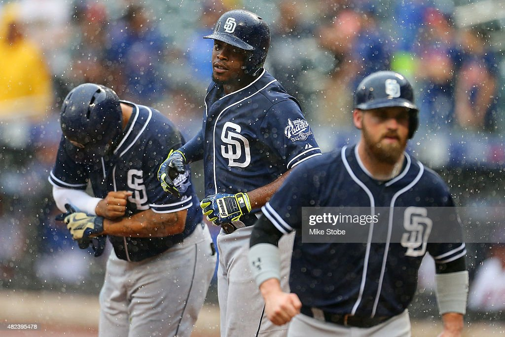 Justin Upton #10 of the San Diego Padres celebrates after hitting a three run home run in the ninth inning against the New York Mets at Citi Field on July 30, 2015 in Flushing neighborhood of the Queens borough of New York City.