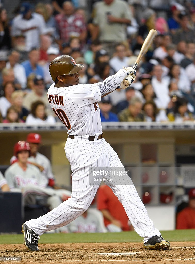 Justin Upton #10 of the San Diego Padres hits a single during the sixth inning of a baseball game against the Philadelphia Phillies at Petco Park August 8, 2015 in San Diego, California.