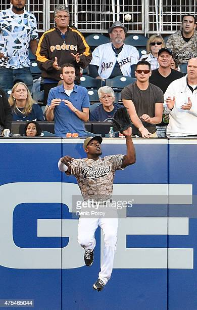 Justin Upton of the San Diego Padres makes a leaping catch at the wall on a ball hit by Gregory Polanco of the Pittsburgh Pirates during the third...