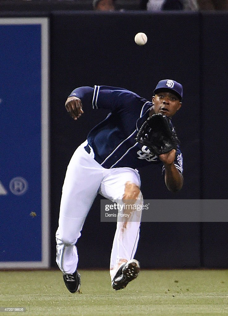 Justin Upton #10 of the San Diego Padres makes running catch on a ball hit by Justin Morneau #33 of the Colorado Rockies during the eighth inning of a baseball at Petco Park May 2, 2015 in San Diego, California.