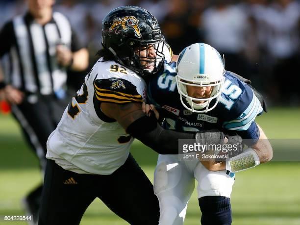 Justin Vaughn of the Hamilton TigerCats sacks Ricky Ray of the Toronto Argonauts during a CFL game at BMO Field on June 25 2017 in Toronto Ontario...