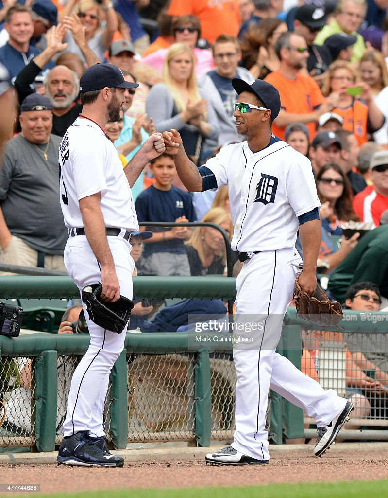 Justin Verlander #35 (L) and Anthony Gose #12 of the Detroit Tigers fist-bump during the game against the Cleveland Indians at Comerica Park on June 13, 2015 in Detroit, Michigan. The Indians defeated the Tigers 5-4.