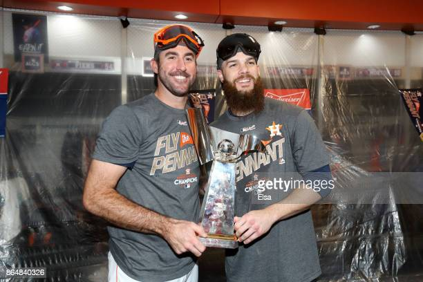 Justin Verlander and Dallas Keuchel of the Houston Astros celebrate with the William Harridge Trophy in the locker room after defeating the New York...