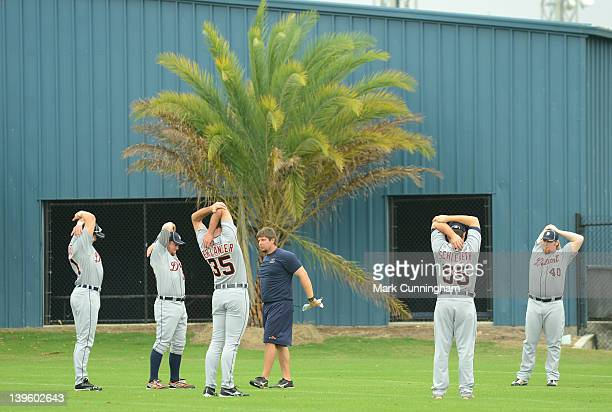 Justin Verlander and Daniel Schlereth of the Detroit Tigers stretch during Spring Training workouts at the TigerTown Facility on February 23 2012 in...
