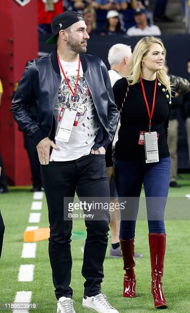 Justin Verlander and Kate Upton on the field for pregame activities before the Houston Texans played the Indianapolis Colts at NRG Stadium on...