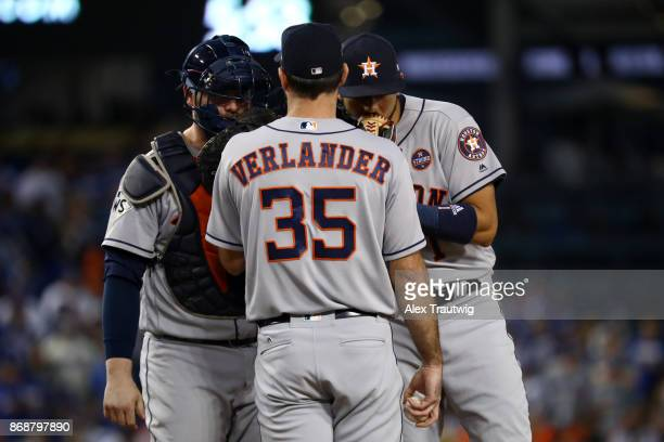 Justin Verlander Brian McCann and Carlos Correa of the Houston Astros meet on the mound during Game 6 of the 2017 World Series against the Los...