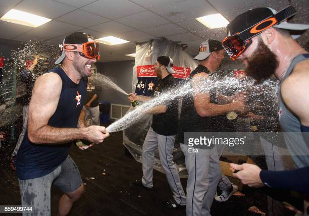 Justin Verlander celebrates with Dallas Keuchel of the Houston Astros in the clubhouse after defeating the Boston Red Sox 54 in game four of the...