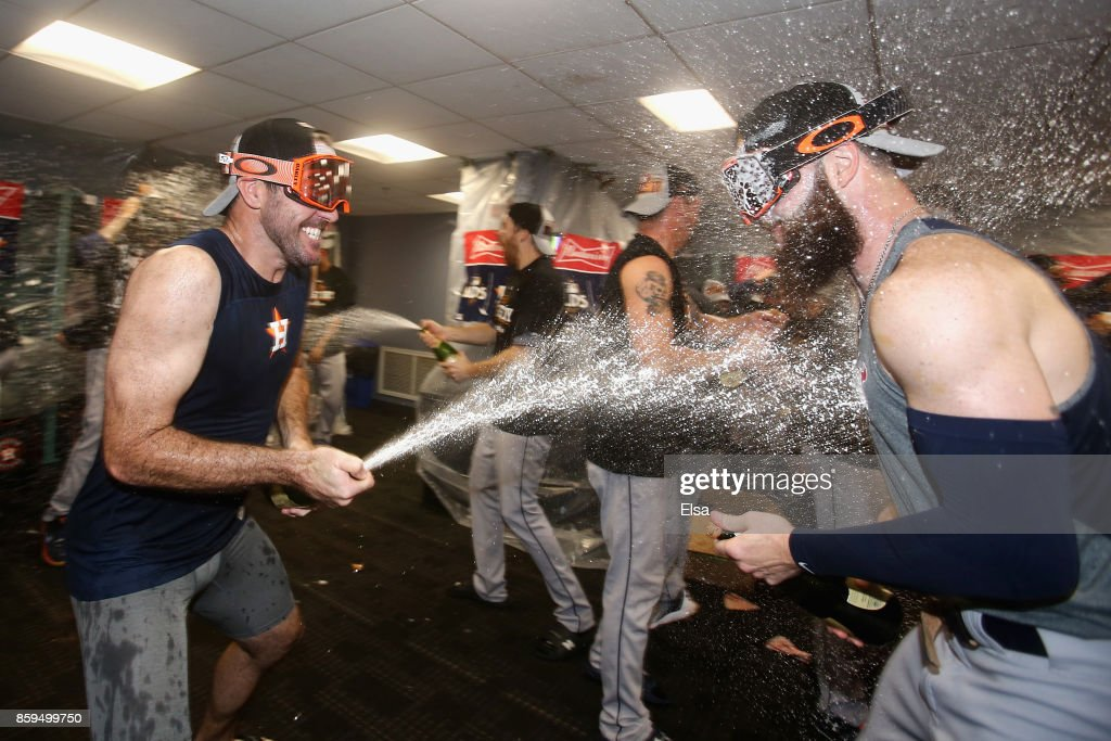 Justin Verlander #35 (L) celebrates with Dallas Keuchel #60 of the Houston Astros in the clubhouse after defeating the Boston Red Sox 5-4 in game four of the American League Division Series at Fenway Park on October 9, 2017 in Boston, Massachusetts. The Astros advance to the American League Championship Series.