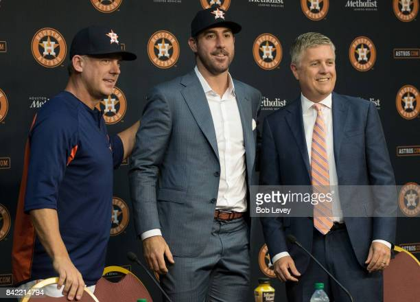 Justin Verlander center along with manager AJ Hinch left and general manager Jeff Luhnow during a press conference to officially introduce Verlander...