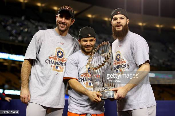 Justin Verlander Jose Altuve and Dallas Keuchel of the Houston Astros hold the Commissioner's Trophy after defeating the Los Angeles Dodgers 51 in...
