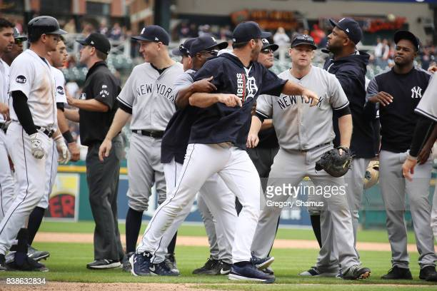 Justin Verlander of the Detroit Tigers gets involved in a seventh inning bench clearing brawl against the New York Yankees at Comerica Park on August...
