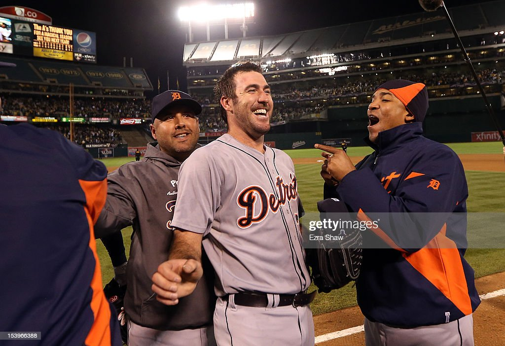 Justin Verlander #35 of the Detroit Tigers is congratulated by teammates after the Detroit Tigers beat the Oakland Athletics in Game Five of the American League Division Series at Oakland-Alameda County Coliseum on October 9, 2012 in Oakland, California.