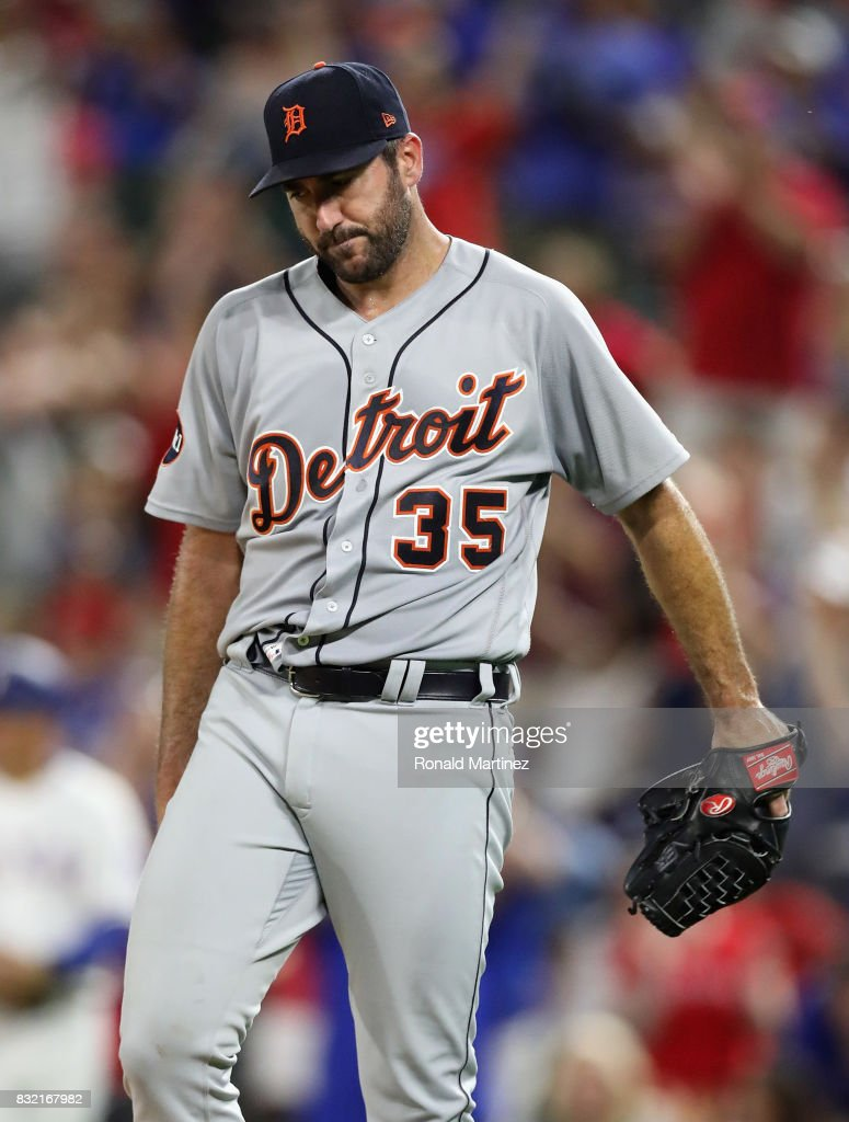 Justin Verlander #35 of the Detroit Tigers reacts after giving up a homerun against Mike Napoli #5 of the Texas Rangers in the fourth inning at Globe Life Park in Arlington on August 15, 2017 in Arlington, Texas.