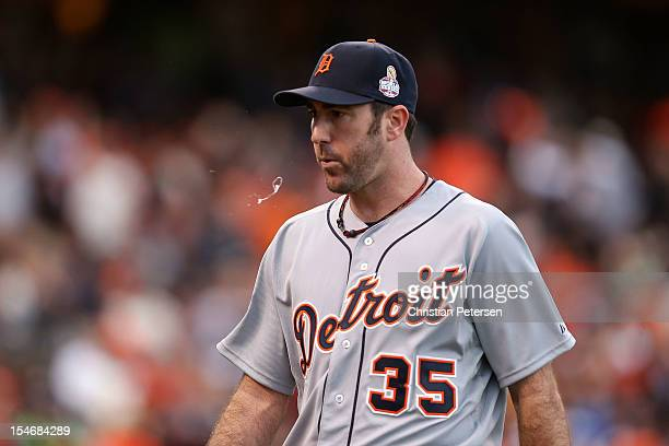 Justin Verlander of the Detroit Tigers spits after throwing a pitch against the San Francisco Giants in the first inning during Game One of the Major...