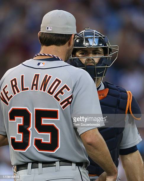 Justin Verlander of the Detroit Tigers talks to Alex Avila on the mound during MLB game action against the Toronto Blue Jays on July 4 2013 at Rogers...