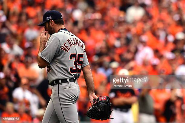 Justin Verlander of the Detroit Tigers walks back to the dugout after being relieved in the sixth inning against the Baltimore Orioles during Game...