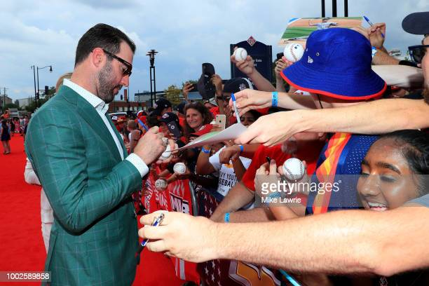 Justin Verlander of the Houston Astros and the American League signs autographs for fans at the 89th MLB AllStar Game presented by MasterCard red...