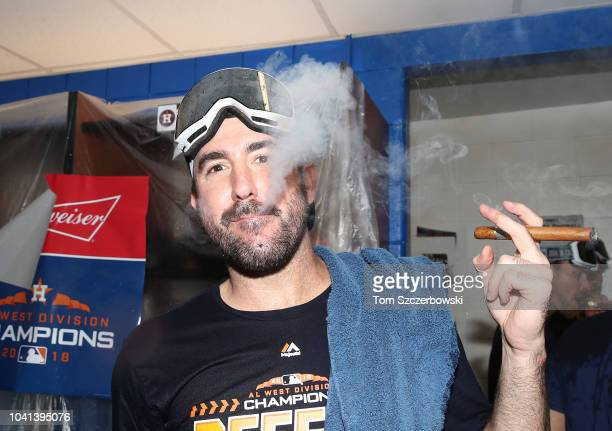 Justin Verlander of the Houston Astros celebrates in the clubhouse after the Astros clinched the American League West division title after their MLB...