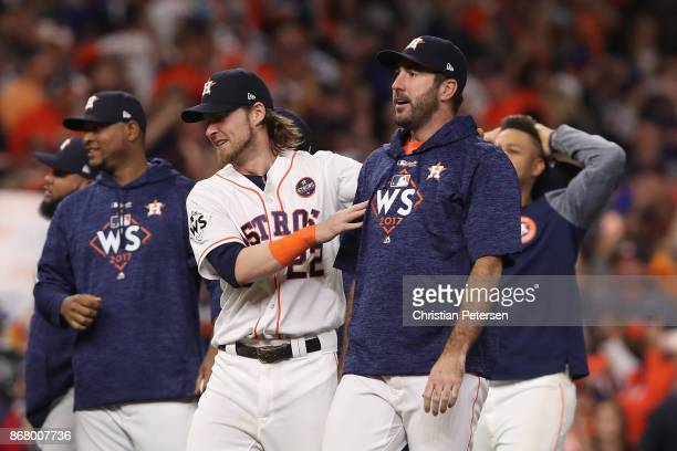 Justin Verlander of the Houston Astros celebrates with Josh Reddick after defeating the Los Angeles Dodgers during the tenth inning in game five of...