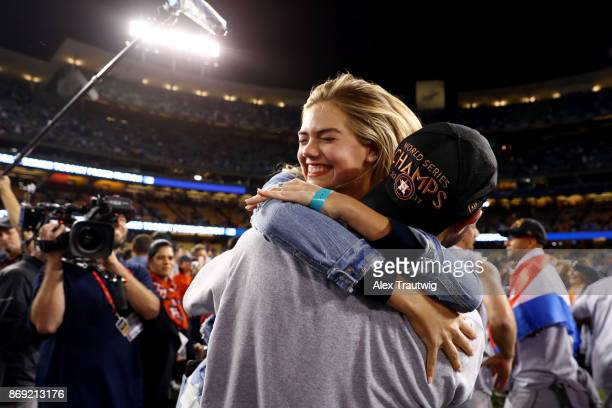 Justin Verlander of the Houston Astros celebrates with Kate Upton after the Astros defeated the Los Angeles Dodgers in Game 7 of the 2017 World...