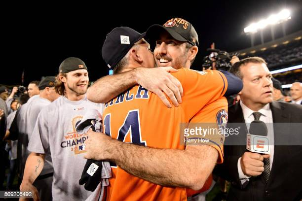 Justin Verlander of the Houston Astros celebrates with manager AJ Hinch after defeating the Los Angeles Dodgers 51 in game seven to win the 2017...