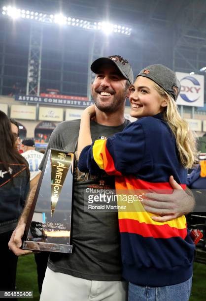 Justin Verlander of the Houston Astros celebrates with model Kate Upton and the MVP trophy after defeating the New York Yankees by a score of 40 to...