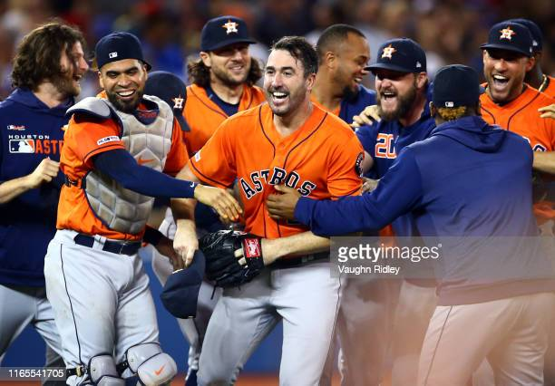 Justin Verlander of the Houston Astros celebrates with teammates after throwing a no hitter at the end of the ninth inning during a MLB game against...