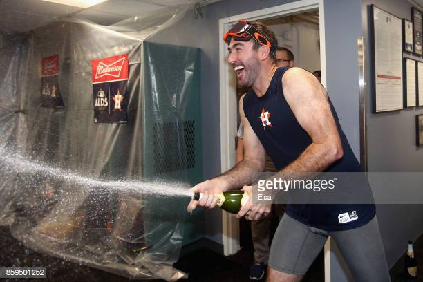 Justin Verlander of the Houston Astros celebrates with teammates in the clubhouse after defeating the Boston Red Sox 54 in game four of the American...
