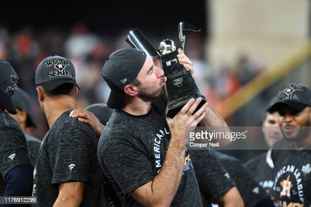 Justin Verlander of the Houston Astros celebrates with the ALCS Trophy after winning the AL pennant with a 6-4 win in Game 6 of the ALCS against the...