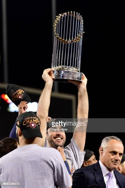 Justin Verlander of the Houston Astros holds the Commissioner's Trophy after defeating the Los Angeles Dodgers 51 in game seven to win the 2017 World...