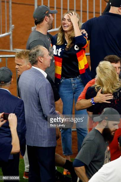 Justin Verlander of the Houston Astros hugs fiance Kate Upton after winning in Game Seven of the American League Championship Series against the New...
