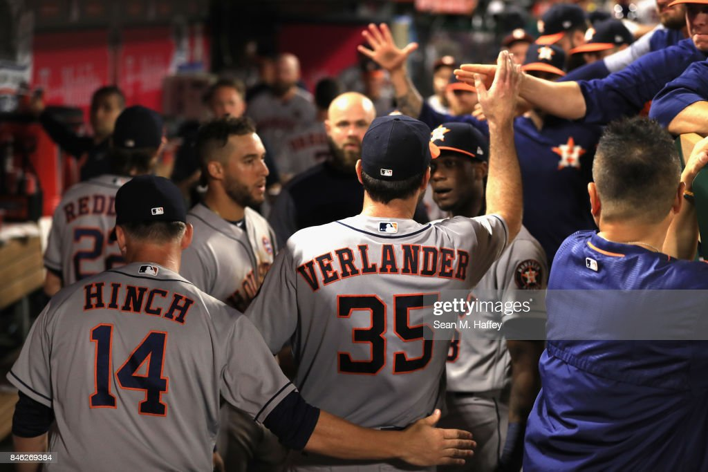 Justin Verlander #35 of the Houston Astros is congratulated in the dugout after the eighth inning of a game against the Los Angeles Angels of Anaheim at Angel Stadium of Anaheim on September 12, 2017 in Anaheim, California.