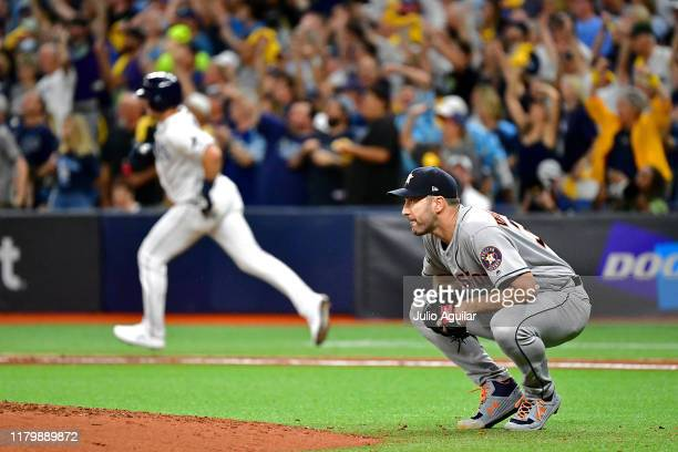 Justin Verlander of the Houston Astros reacts after allowing a home run to Willy Adames of the Tampa Bay Rays during the fourth inning in game four...