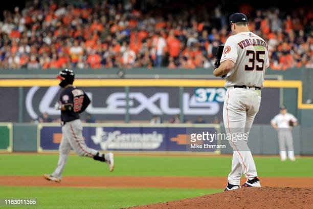 Justin Verlander of the Houston Astros reacts after allowing a home run to Kurt Suzuki of the Washington Nationals during the seventh inning in Game...