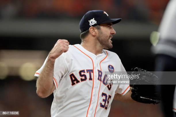 Justin Verlander of the Houston Astros reacts after Chase Headley of the New York Yankees grounded out to close out the top of the seventh inning in...