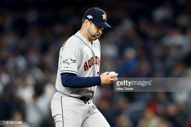 Justin Verlander of the Houston Astros reacts after giving up a home run to DJ LeMahieu of the New York Yankees during the first inning in game five...