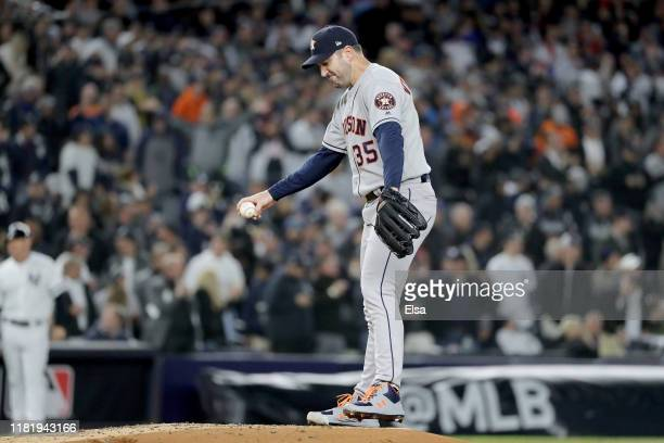Justin Verlander of the Houston Astros reacts after giving up a three run home run to Aaron Hicks of the New York Yankees during the first inning in...