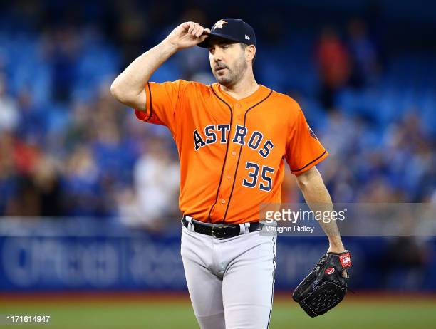 Justin Verlander of the Houston Astros reacts after Reese McGuire of the Toronto Blue Jays strikes out swinging in the ninth inning during a MLB game...