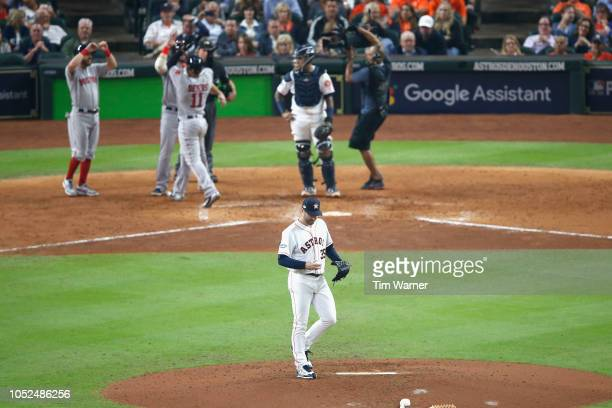 Justin Verlander of the Houston Astros reacts to a home run by Rafael Devers of the Boston Red Sox as Devers celebrates with teammates in the sixth...