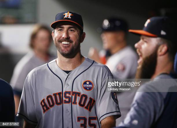 Justin Verlander of the Houston Astros smiles in the dugout after finishing the sixth inning against the Seattle Mariners only giving up only one run...
