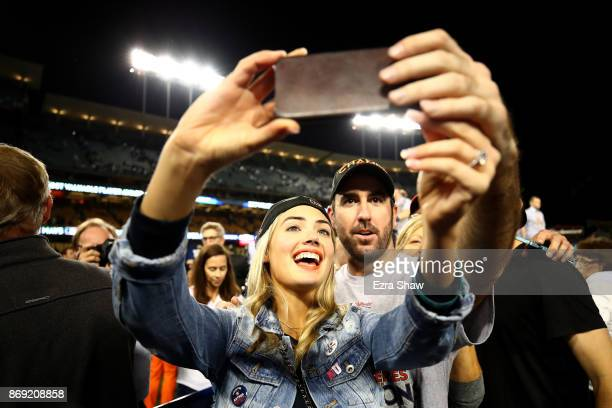 Justin Verlander of the Houston Astros takes a picture with fiancee Kate Upton after the Astros defeated the Los Angeles Dodgers 51 in game seven to...