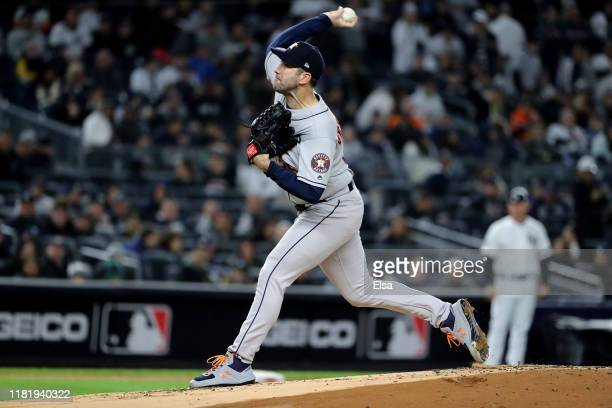 Justin Verlander of the Houston Astros throws a pitch against the New York Yankees during the first inning in game five of the American League...